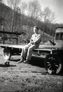 Trueman MacHenry on farm truck