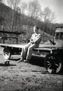 Trueman MacHenry on farm truck